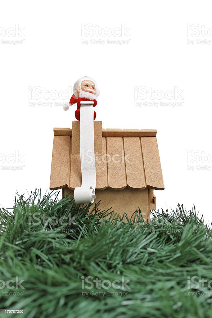 Santa and the huge wish list royalty-free stock photo