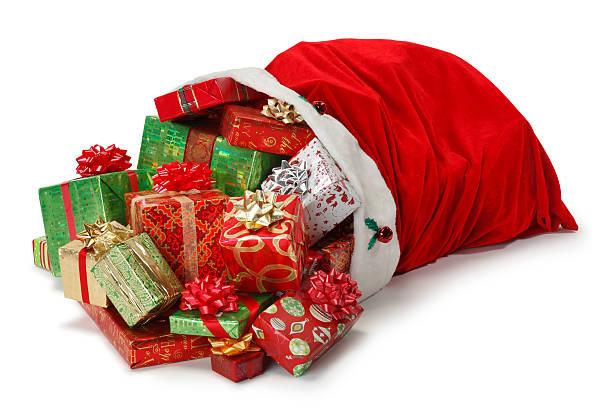 santa bag full of christmas presents - zak tas stockfoto's en -beelden