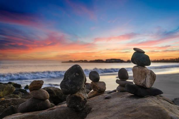 Santa Barbara beach sunset with balanced rocks stock photo