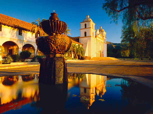 Santa Barbara Mission Fountain With Reflection Of Santa Barbara Mission santa barbara california stock pictures, royalty-free photos & images