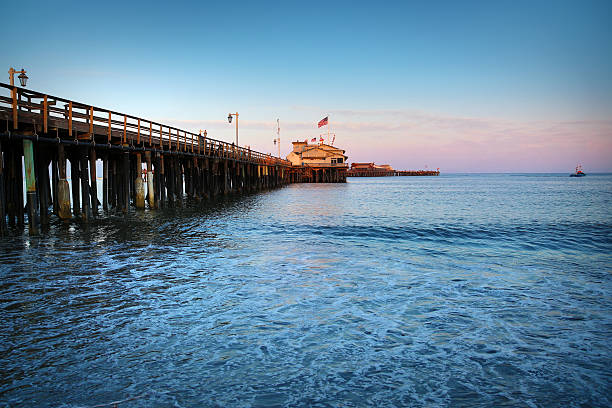 Santa Barbara Pier at Sunset in California This is a photo of the Santa Barbara pier in California. There is a lot of space for copy or cropping. santa barbara california stock pictures, royalty-free photos & images