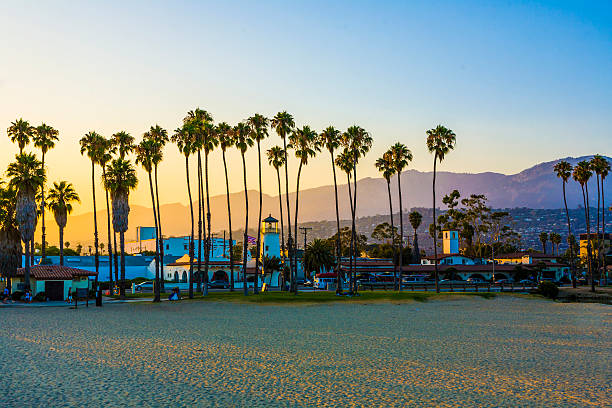 Santa Barbara promenade with the lighthouse over mountains scenic promenade with lighthouse and palms in Santa Barbara in sunset santa barbara california stock pictures, royalty-free photos & images