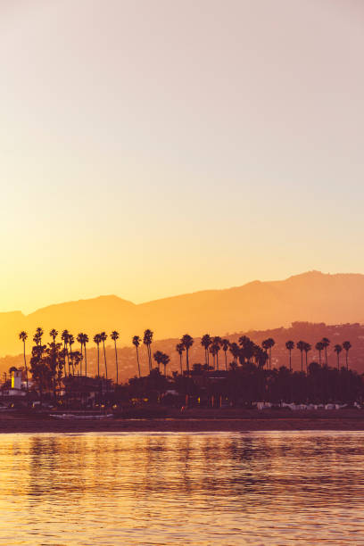 Santa Barbara Sunset with Palm Trees View over Santa Barbara at Sunset santa barbara california stock pictures, royalty-free photos & images