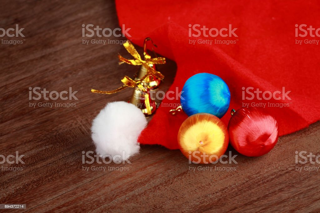 Santa cap and decorations on a wooden background stock photo