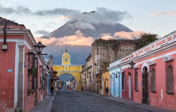 Santa Catalina Arch Agua Volcano Sunrise Antigua Guatemala stock photo