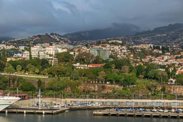 santa catarina park and marina in funchal, madeira - rain clouds porto portugal imagens e fotografias de stock
