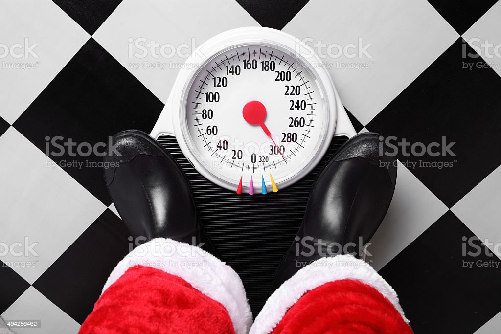 Santa Checking Weight stock photo