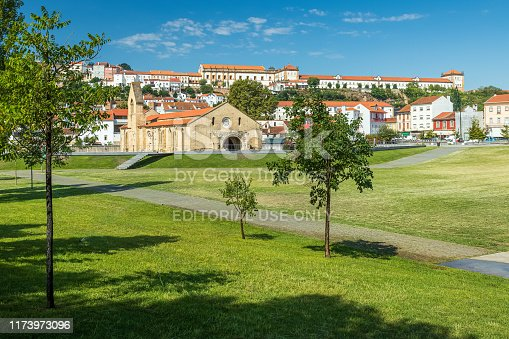 Coimbra, Portugal - August 23, 2019: With lawns in the foreground and Santa Clara a Nova Monastery in the background, on a sunny day and blue sky.