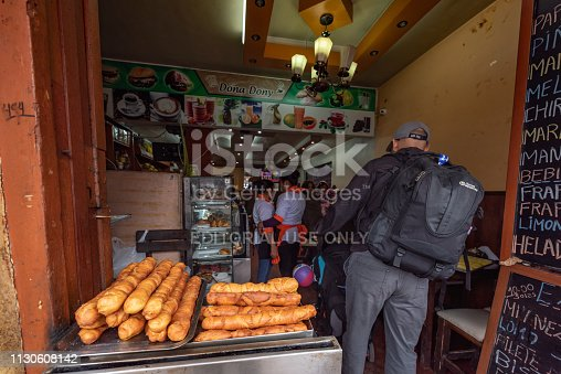 Cusco, Peru - Oct 17, 2018: Santa Clara Street Scene in central Cusco with old colonial architecture, Local snack shop beside the street is waiting for tourists to shop.