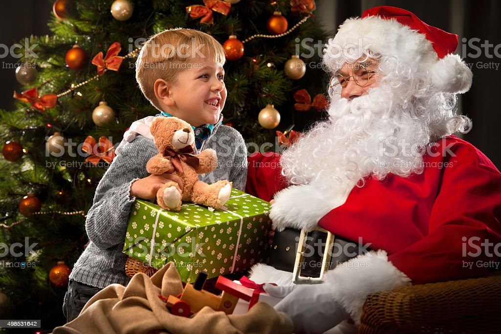 Santa Claus and a little boy stock photo