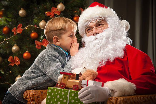 santa claus and a little boy stock photo - Pictures With Santa Claus