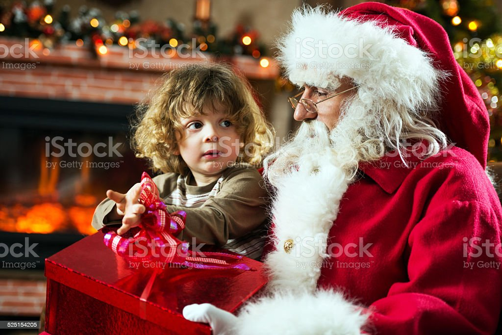 Santa Claus and little boy. stock photo
