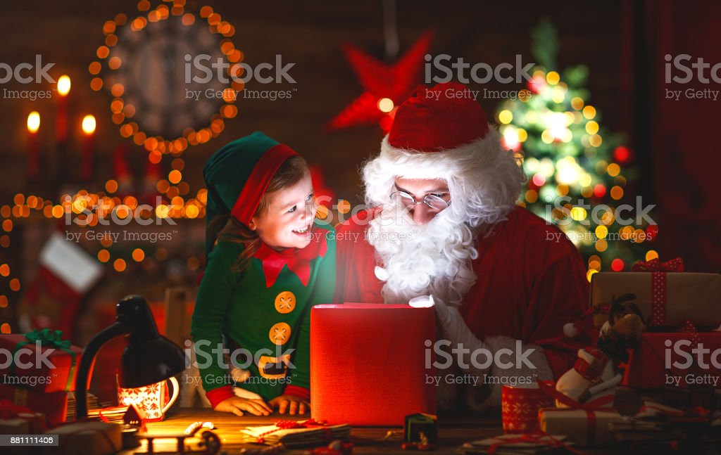 Santa Claus And Little Elf With Magic Gift For Christmas Stock Photo ...