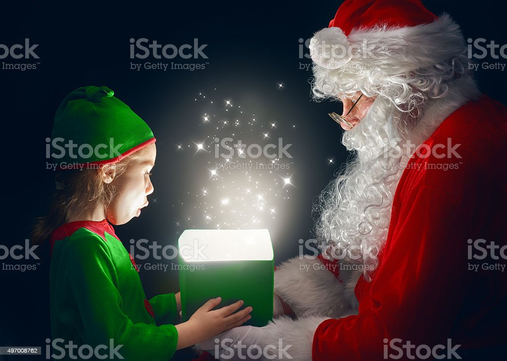 Santa Claus and little girl stock photo