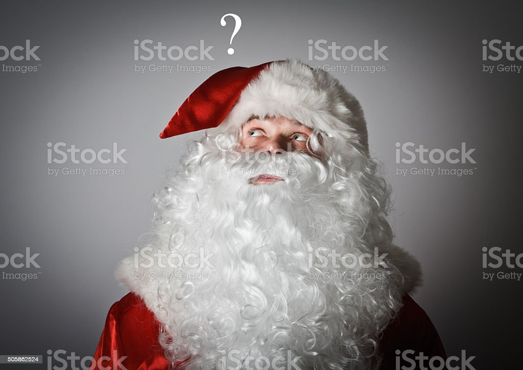 Santa Claus and question mark stock photo