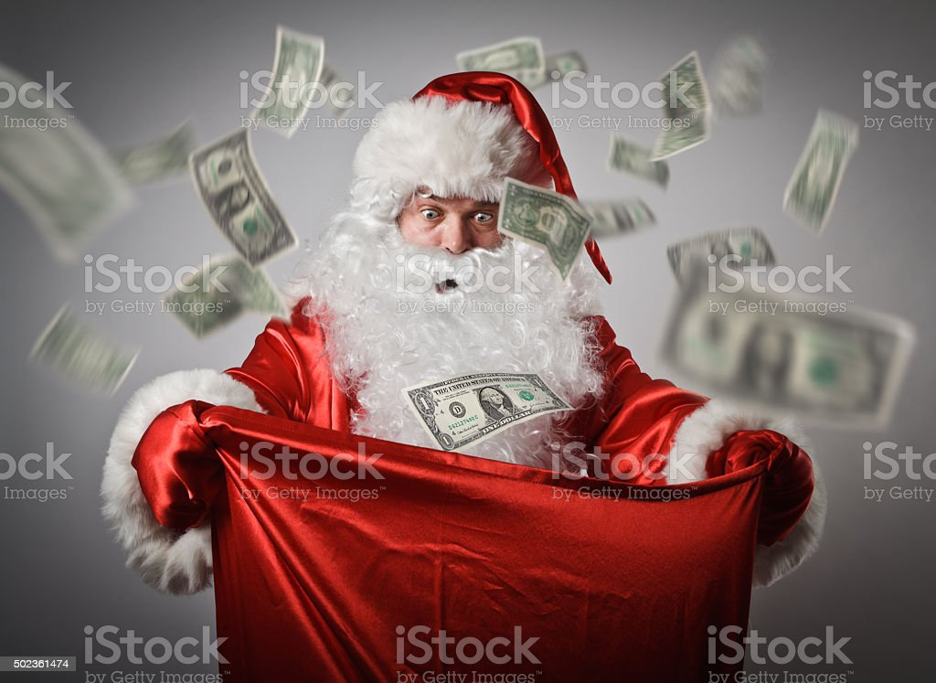 Santa Claus and sack with dollars. stock photo