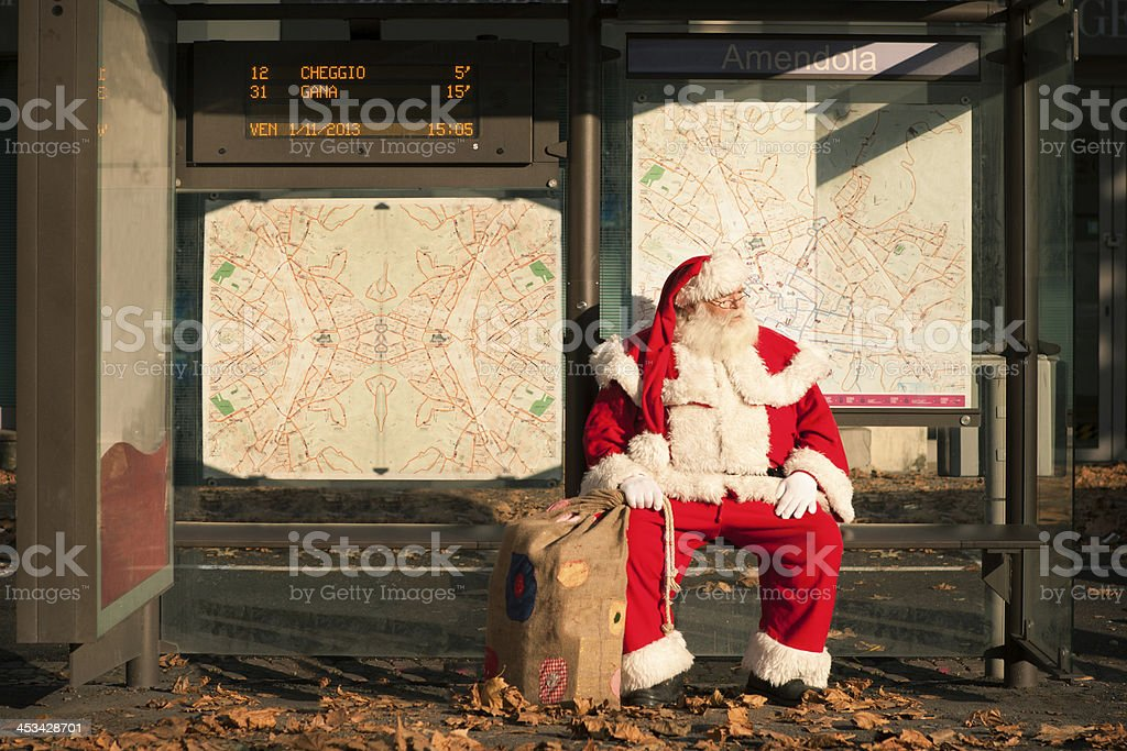Santa Claus at the bus stop stock photo