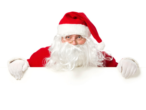 istock Santa Claus behind the blank sign with copy space 157826959
