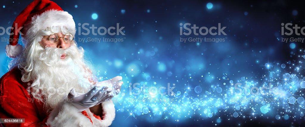 Santa Claus Blowing Magic Christmas Stars In Snowy Night – Foto