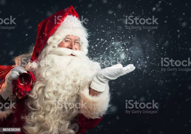 Santa claus blowing magic snow of his hands picture id865836056?b=1&k=6&m=865836056&s=612x612&h=kagmxvyblcpg3s4upp4wkmojh0r6ahza05gye 0wqna=