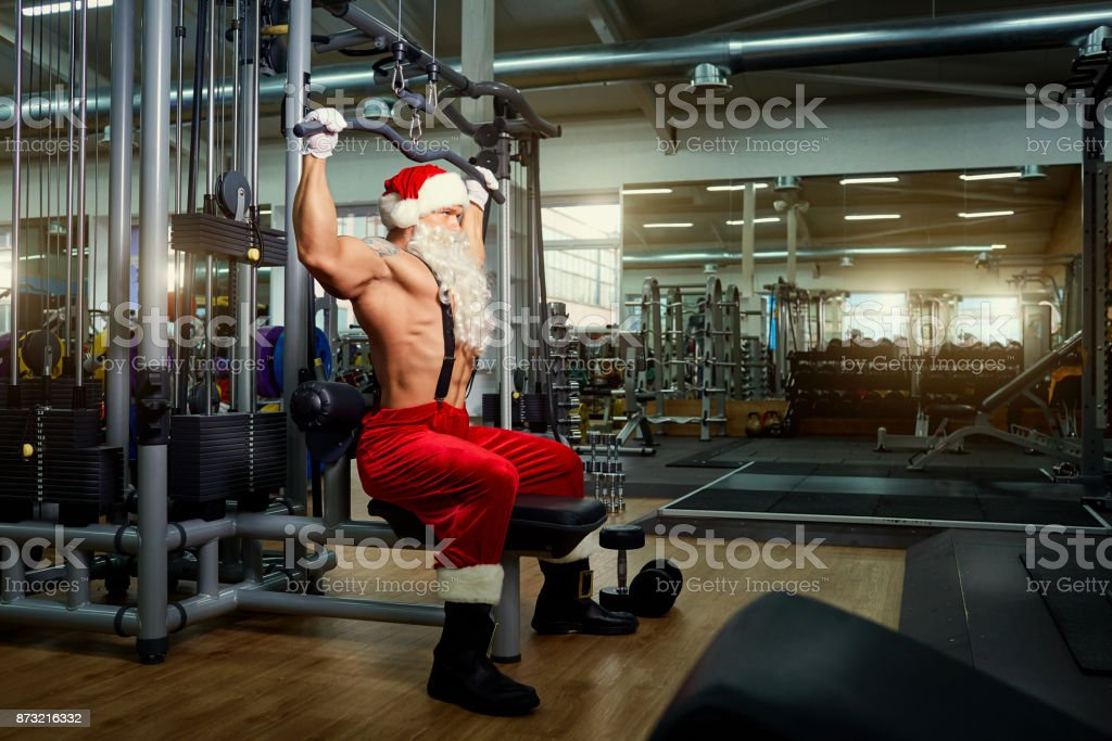 Santa Claus Bodybuilder training at the gym on Christmas Day stock photo