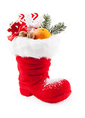 Santa Claus boots filled with sweets and gifts