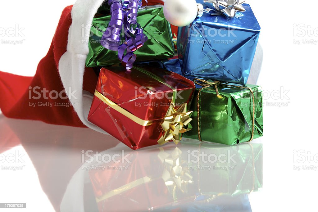 Santa claus cap with Christmas gifts royalty-free stock photo