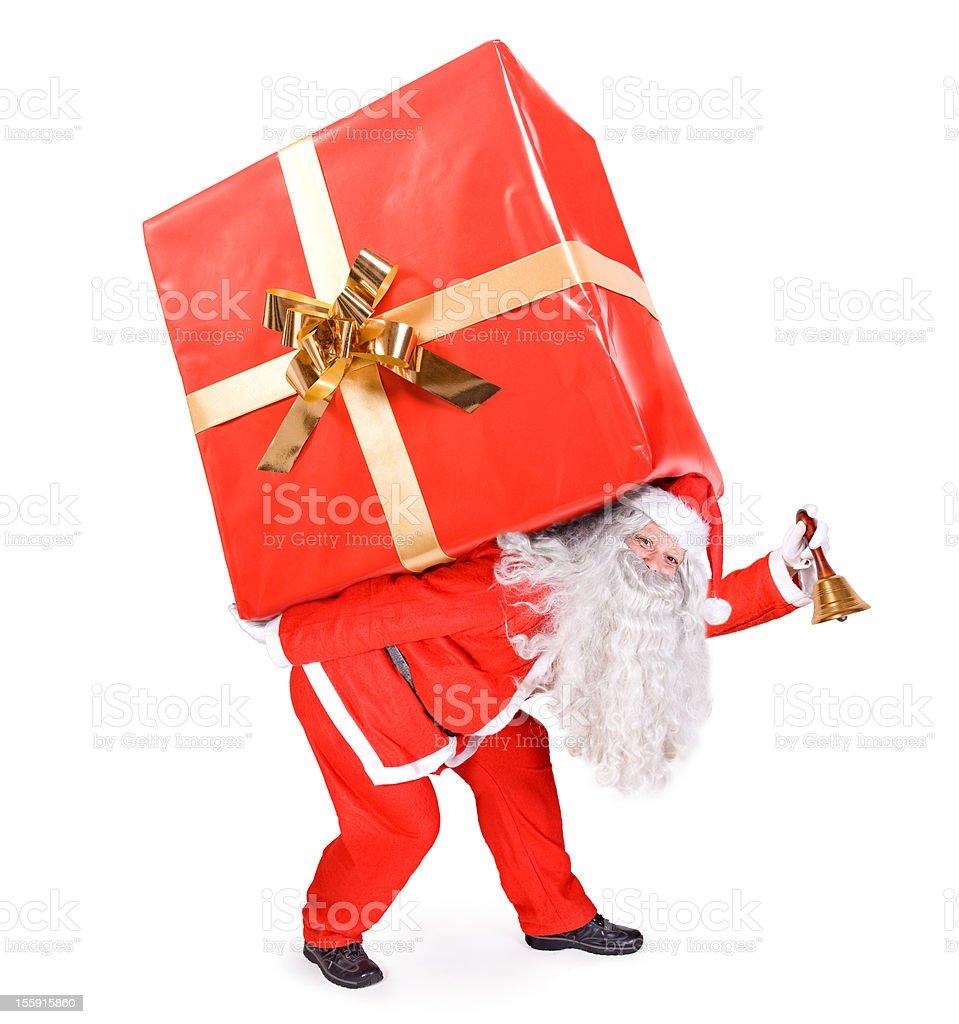 Santa Claus carries a big gift royalty-free stock photo