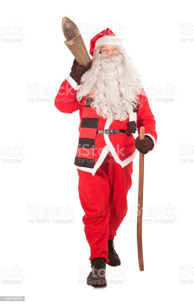Santa Claus carries skis stock photo