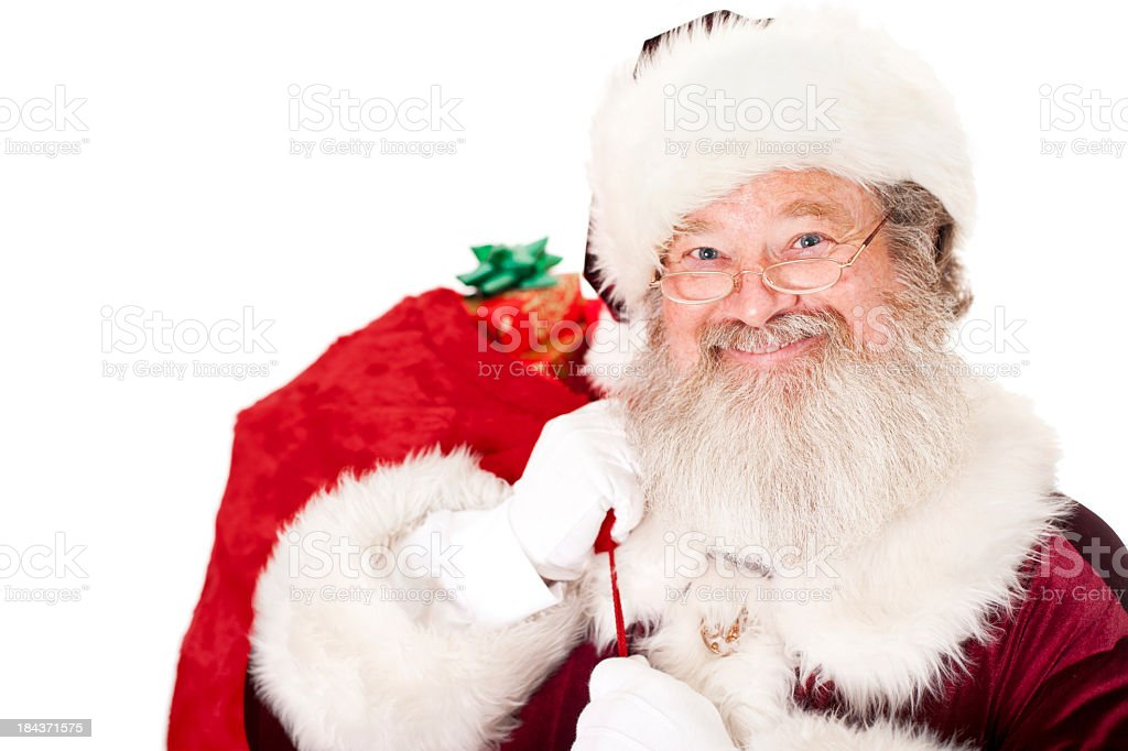 Santa Claus Carrying Sack of Presents stock photo