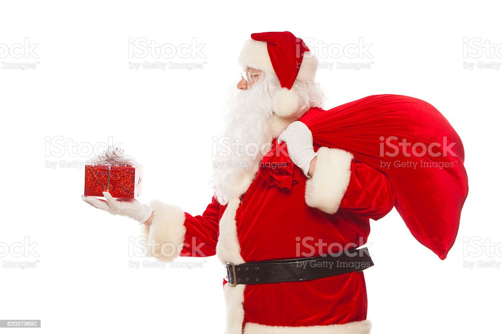 Santa Claus: Cheerful With Small Stack Of Gifts big bag zbiór zdjęć royalty-free