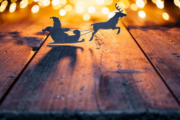 Santa Claus Christmas decoration on old wood - Reindeer Candle Jar Card stock photo