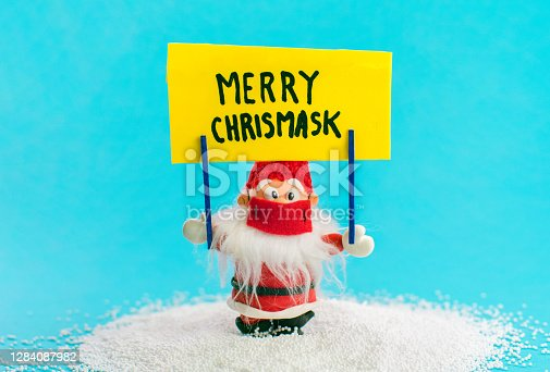 Santa Claus Christmas during pandemic, conceptual background with text Merry Christmask