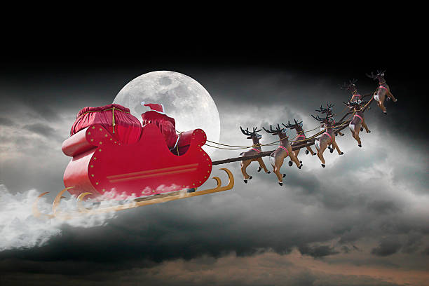 Santa Claus cloudy night Santa Claus riding a sleigh led by reindeers on a cloudy night sleigh stock pictures, royalty-free photos & images