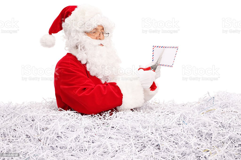 Santa claus cutting a letter with scissors stock photo istock adult adults only cap caucasian ethnicity christmas santa claus cutting a letter spiritdancerdesigns Gallery