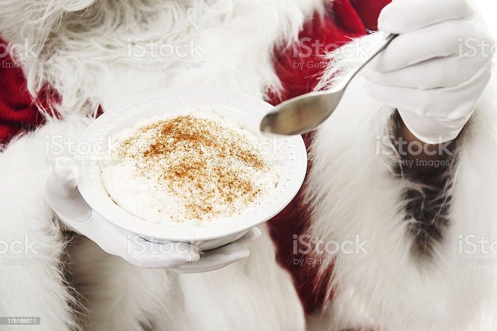 Santa Claus eating rise porridge stock photo
