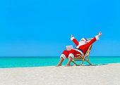 2b36640d Santa Claus Working On Beach With Laptop Computer Stock Photo & More ...