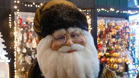 Santa Claus figure in the store on christmas background. Happy New Year concept.