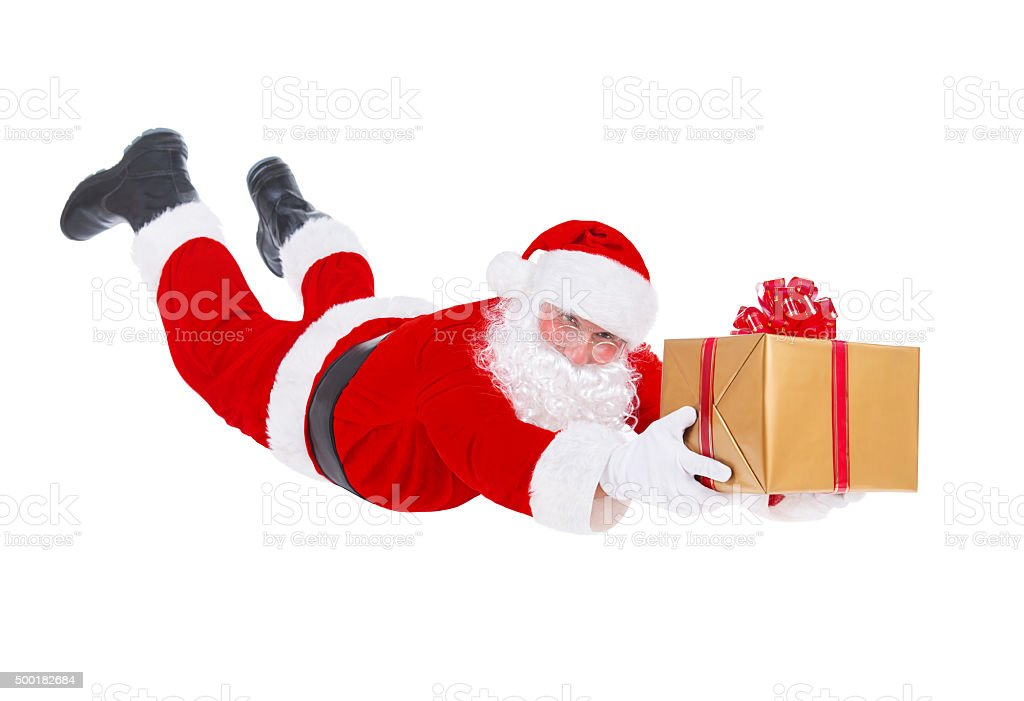 Santa Claus flying with Christmas gift isolated on white background stock photo