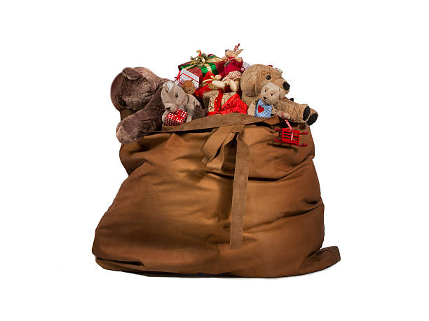 Santa Claus gift bag full of toys and gifts stock photo
