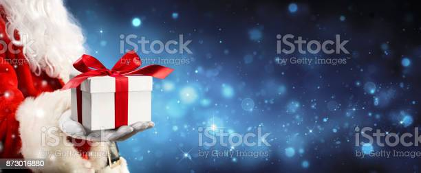 Santa claus giving a giftbox in magic night picture id873016880?b=1&k=6&m=873016880&s=612x612&h=rargveyjdgw 1a  ikx uiilh olsstfo41tcfirxpu=