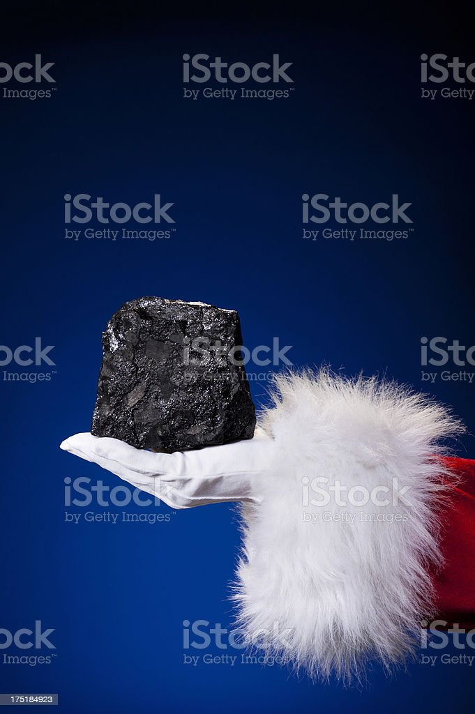 Santa Claus Hand - Coal stock photo
