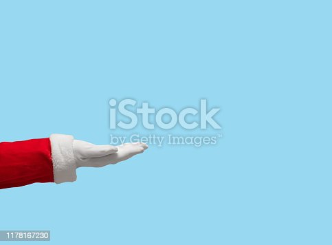 istock Santa Claus hand on blue isolated background. 1178167230