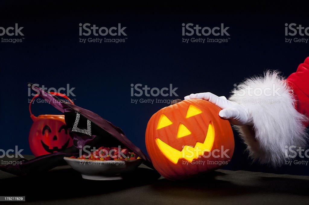 Santa Claus Hand - Pushing out Halloween royalty-free stock photo