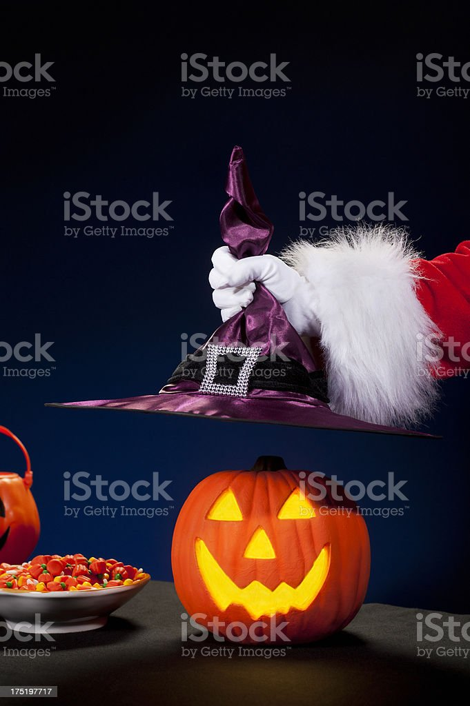 Santa Claus Hand - Witch Hat royalty-free stock photo
