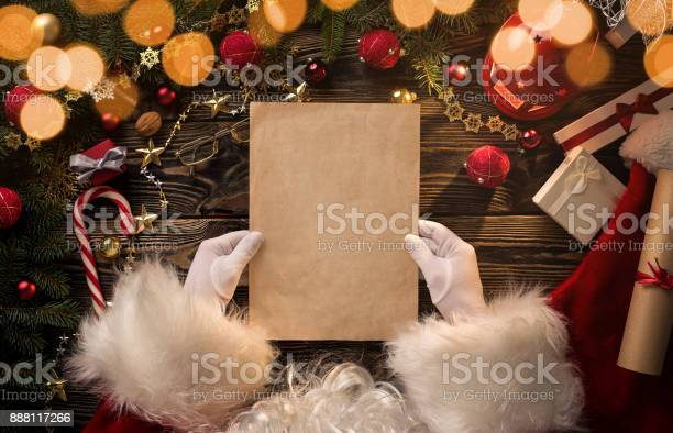 Santa claus hands holding reading blank letter picture id888117266?b=1&k=6&m=888117266&s=612x612&h=g33o0cwsygkvijz7lp5vvtra51l3z1ezn 4bmbtcbfo=