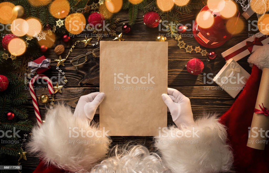 Santa Claus hands holding, reading blank letter stock photo