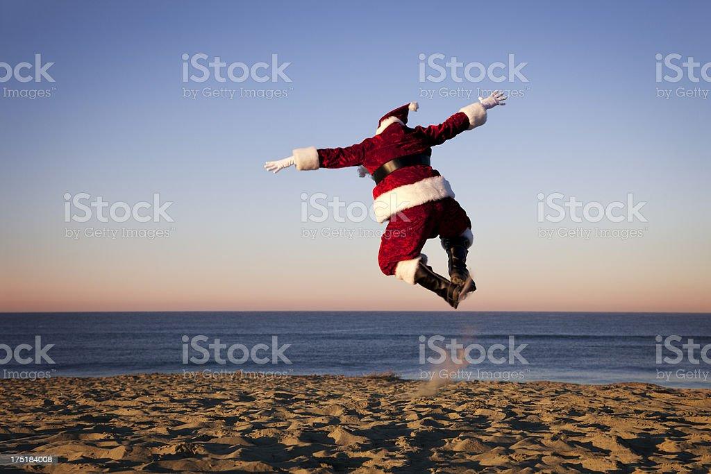 Santa Claus Happy on Vacation at the Beach stock photo