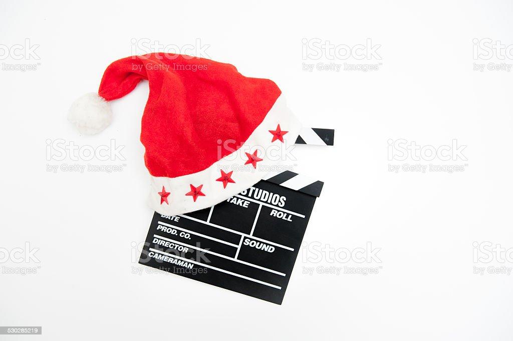 42a7b728a0533 Sombrero de Santa Claus en una película clapper de planchar foto de stock  libre de derechos