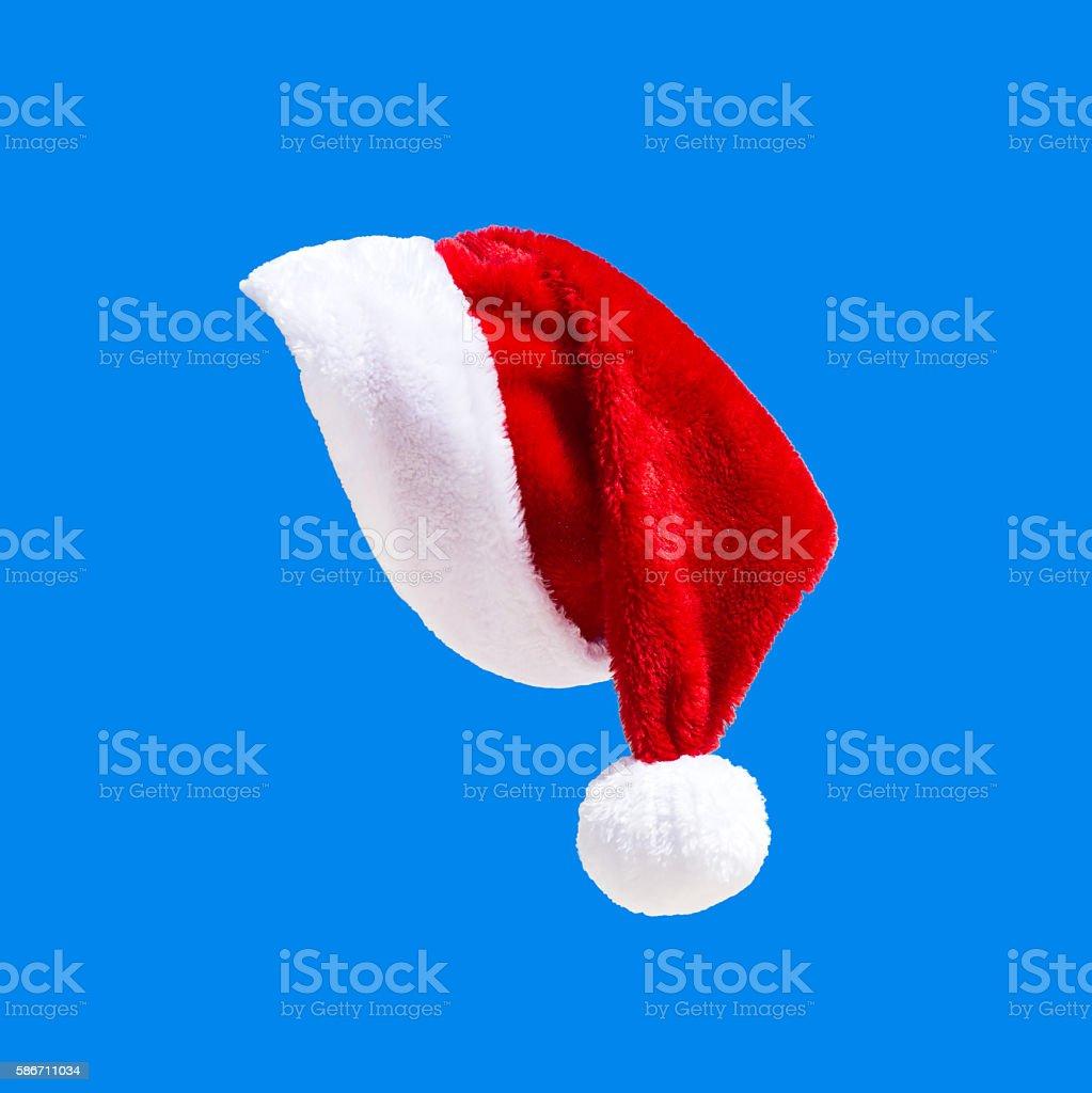 Santa Claus hat on blue stock photo